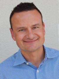 Brian Adam, President of Olympus Group
