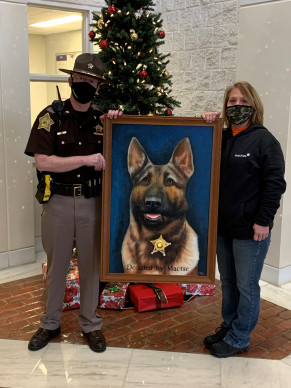 Mactac donated a large, painted portrait of K-9 Diesel to the Bartholomew County Sheriff's Office