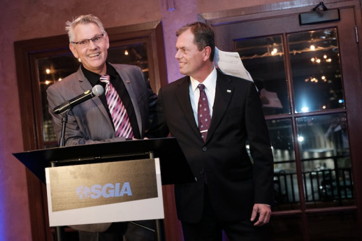 Rich Tompson (left) of Ad Graphics welcomes Edward Cook Jr. of ECI Screen Print to the position of Chairman, SGIA (Booth 2245) Board of Directors.