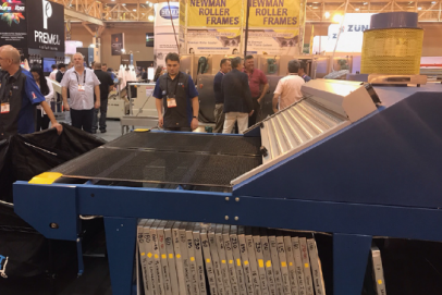 Attendees are captivated by the SPRINT 3000 gas screen printing conveyor dryer, a 72-inch dryer with a dual heat and dual belt system that can run simultaneously, or at different speeds and at different temperatures.