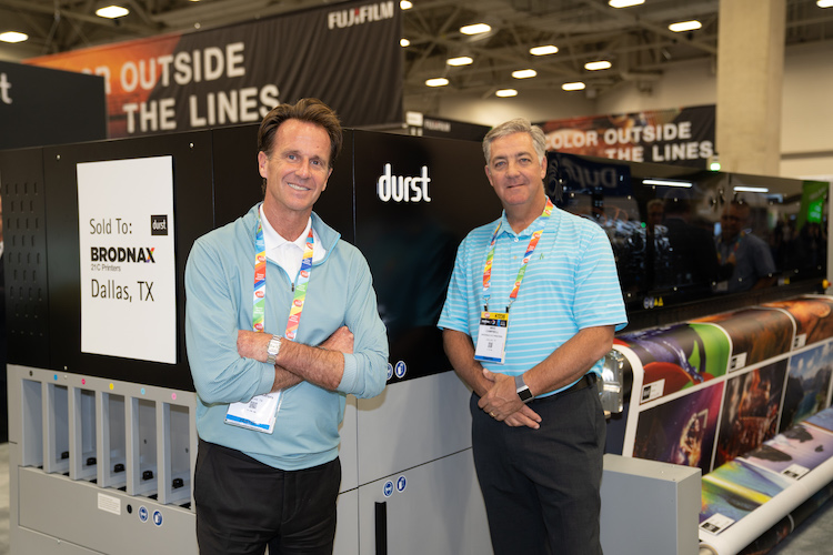 Sealing the purchase of a Durst P5 series large-format printer by Broadnax 21C Printers at PRINTING United were, from left, Broadnax's Jim Singer and Mike Campbell.