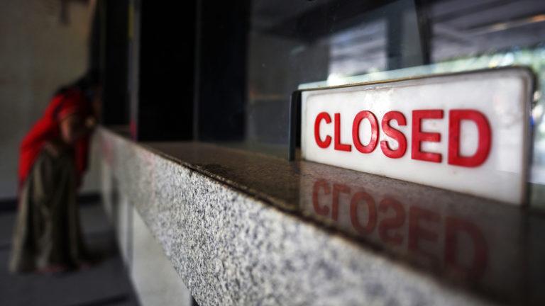 Closed sign on reception desk.