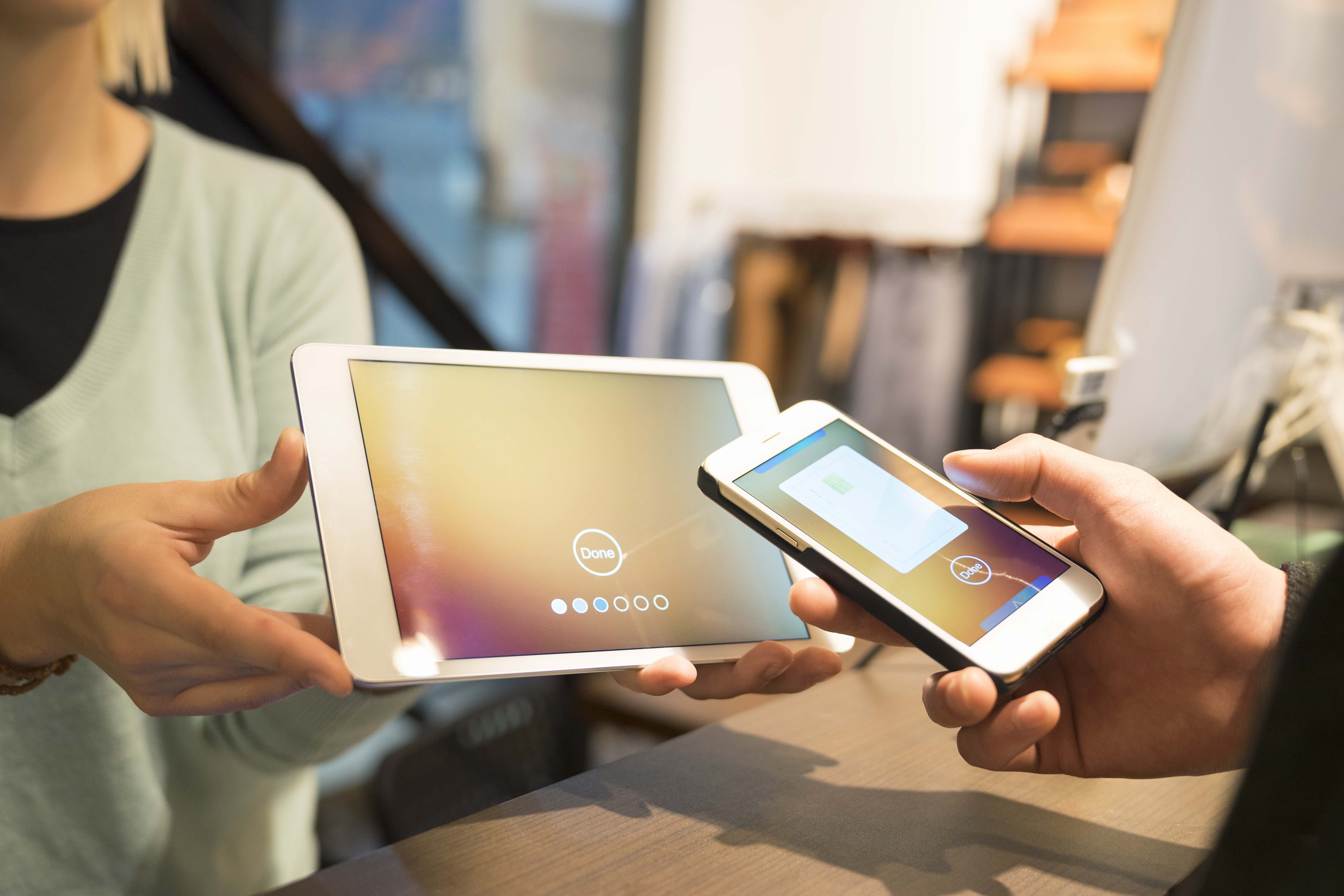 Smart phone payment to a tablet.