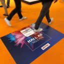 Installing floor graphics on carpet presents an added challenge.