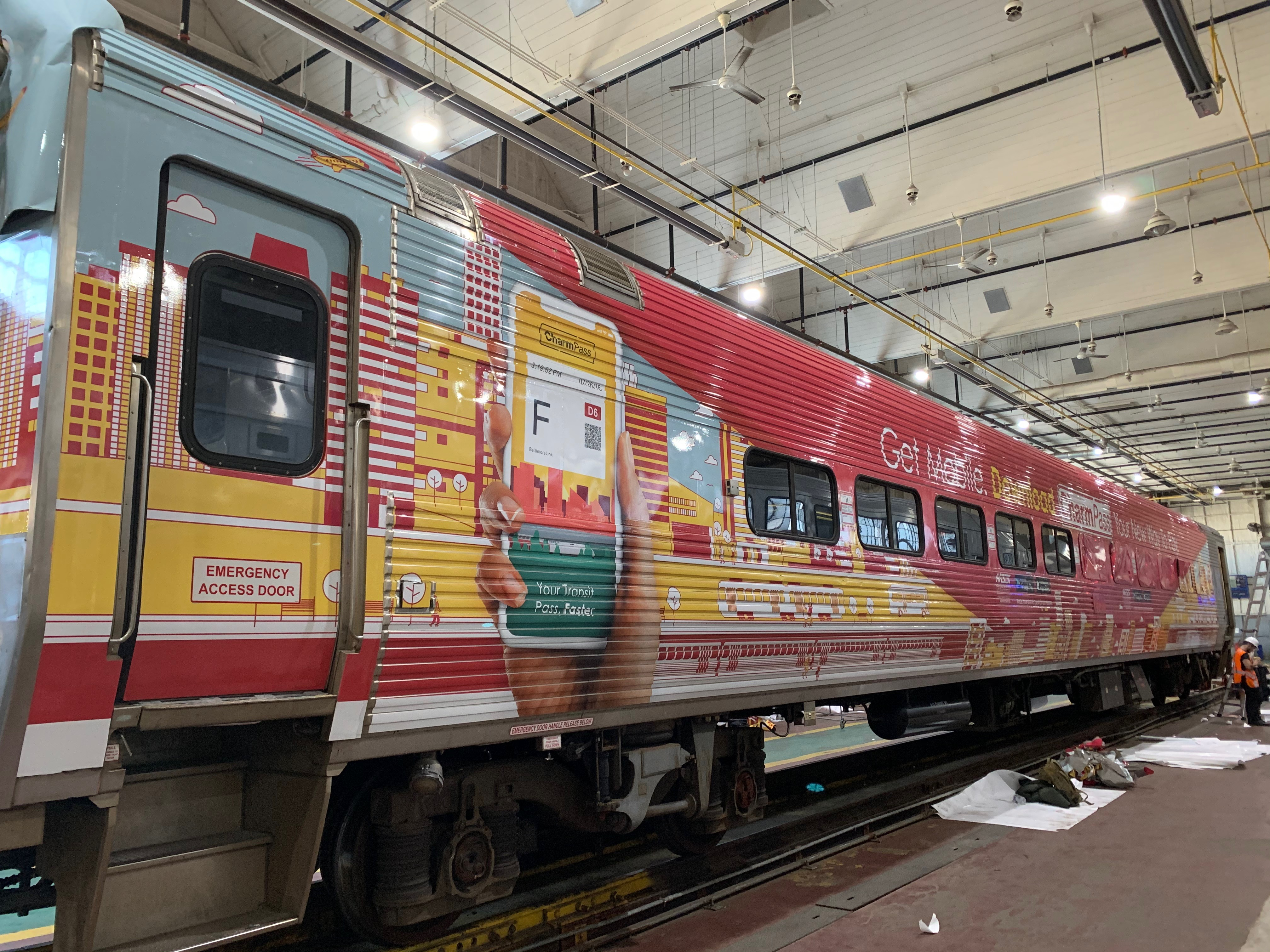 Train car, exterior applied graphics wrap by Axis Graphic Installations