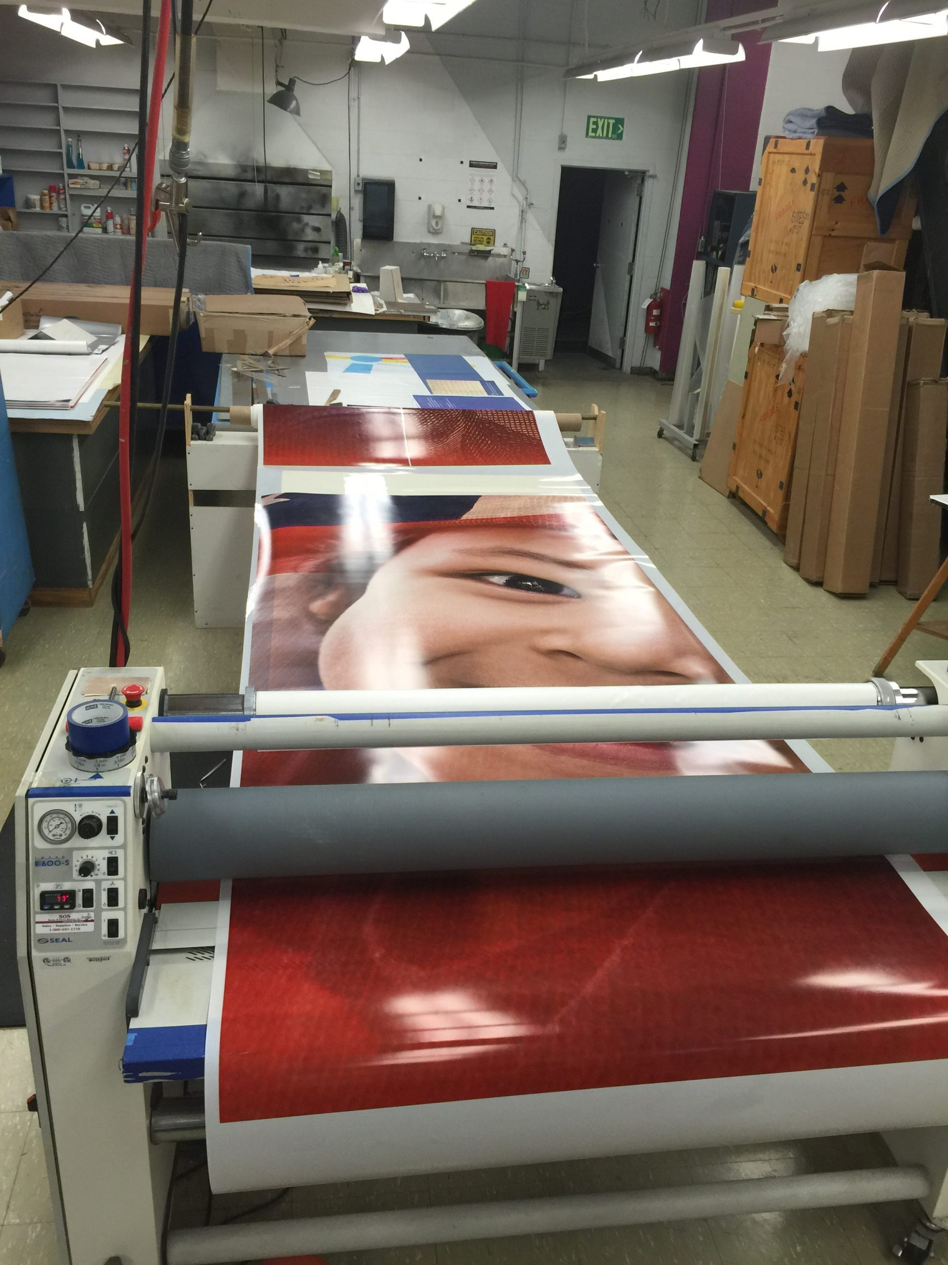 Laminating large window graphics at the Smithsonian Museum of American History.